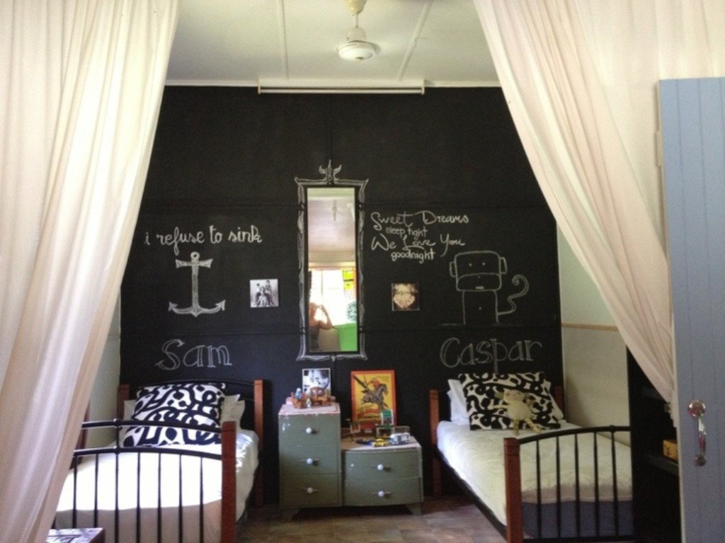 bedroom-design-with-wall-decorative-chalkboards-hobby-feat-wall-mirror-and-wood-twin-bed-frame-combine-white-curtains